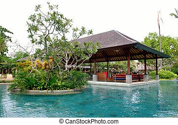 View of tropical resort swimming pool scene in morning