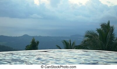 Swimming Pool on the mountain with infinity sea view in a jungle. Slow motion.