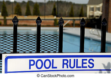 Swimming Pool Rules - swimming pool rules sign on the entry...