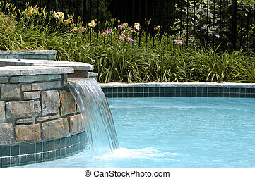 Swimming pool waterfall - Beautifully landscaped pool with ...