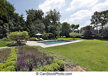 Swimming pool with brick deck
