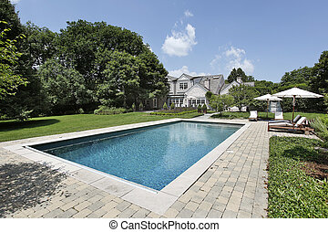 Swimming pool with deck chairs - Swimming pool of luxury ...