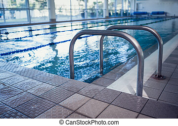 Swimming pool with hand rails at the leisure center