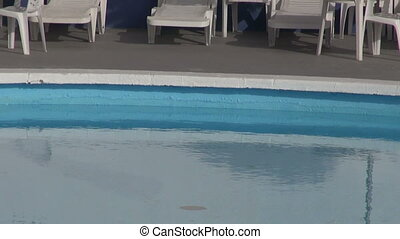 swimming pool with lounges