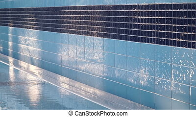 swimming pool with running water on the wall