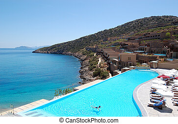 Swimming pool with sea view at the luxury hotel, Crete, ...