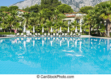 Swimming pool with water in open air