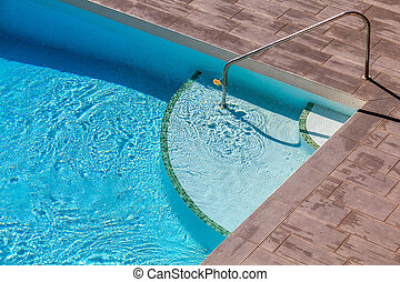 Swimming Pool with wooden floor beside