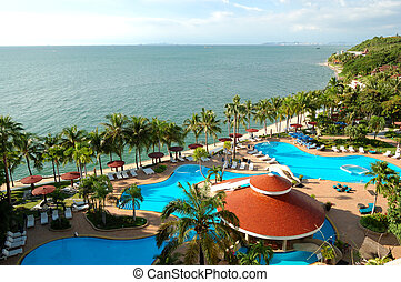 Swimming pools and bar at the beach of luxury hotel, Pattaya, Thailand