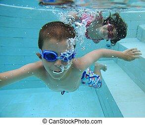 Swimming underwater - Boy and girl swimming underwater