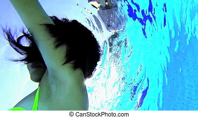 Swimming underwater - Happy girl underwater smiling and...
