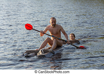 raft with a man on a lake