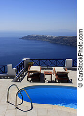 Swimmingpool set on a hill overlooking the sea.