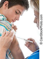 swine flu shot - teenager getting a swine flu injection