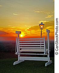 swing chair under beautiful sunset