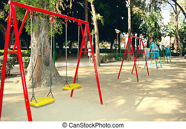 Swing chairs in playing garden