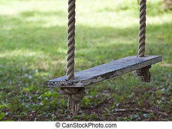 swing hanging in garden