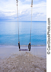 Swing on the beach with blue sky