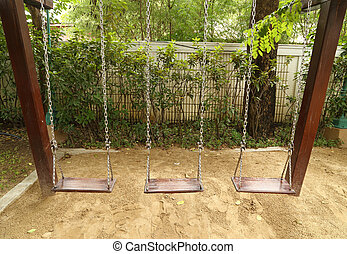 swing set on the playground - wooden swing set on the...