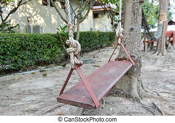 Swing under the tree