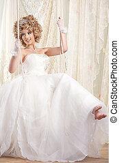 Swinging Bride - Beautiful blond bride on swing. Girl is ...