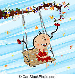 Swinging girl - Image shows a happy girl swinging and having...