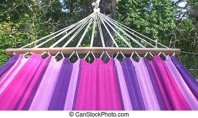 Swinging Hammock - Swinging in Hammock Outdoors Garden