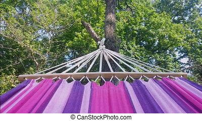 Swinging in Hammock Outdoors Garen