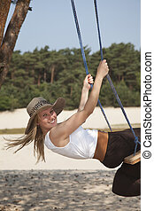 swinging lady in nature