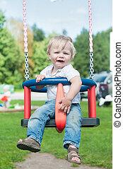 Swinging little boy