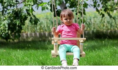Swinging - Little girl having a good time swinging