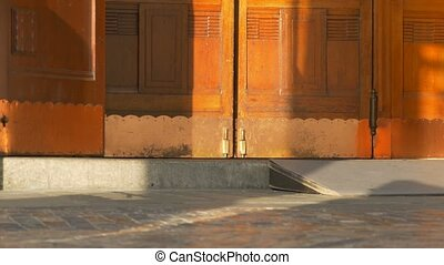 Swinging wooden old doors at the entrance of a building.