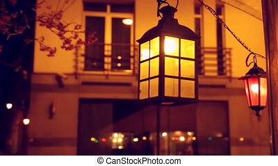 Swinging retro lamp at night.
