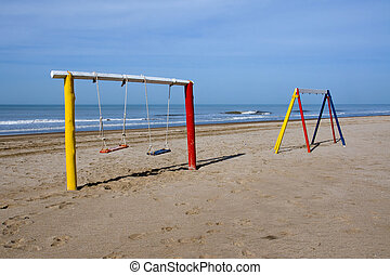 Swings at the beach
