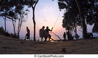Swings by the Sea at Sunset