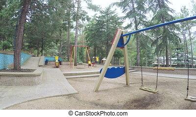 Swings in playground - Circling stedikamom playground in...