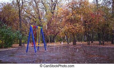 Swings in the park. It's snowing, Ekaterinburg, Russia