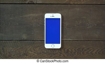 Swipes Left Hand Smartphone with Blue Screen