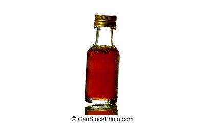 Swirling bottle of red liquid