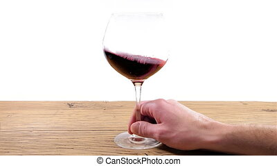 Swirling red wine glass - Swirling or rolling a red wine...