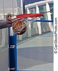 Swish - A basketball swishing through the basket of a goal