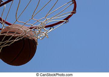 Swish! - Basketball going through net against blue sky
