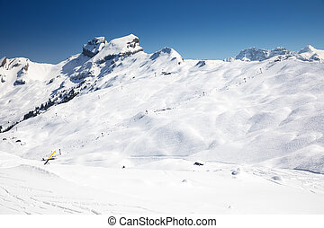 Swiss Alps covered by fresh new snow seen from Hoch-Ybrig ski resort, Central Switzerland, Europe.