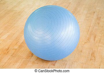 Swiss ball - Pilates ball on a wooden floor in a gym