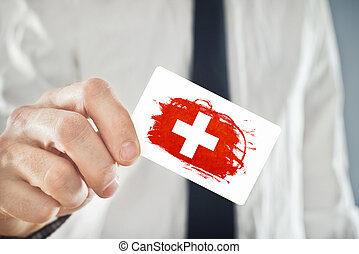 Swiss Businessman holding business card with Switzerland Flag
