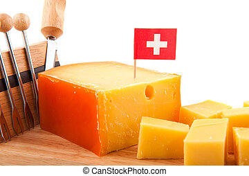 Swiss cheese with flag as snack with knife and picks