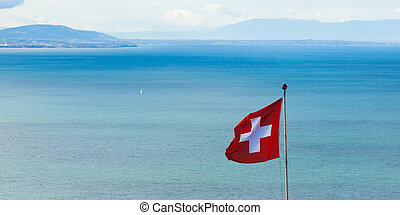 Swiss flag floating in the wind - Switzerland