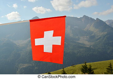 Swiss flag in the wind against sky