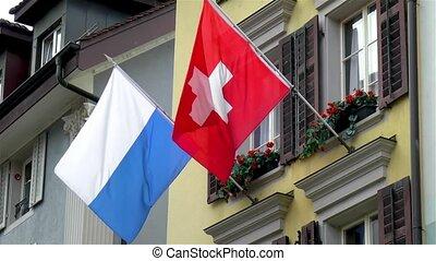 Swiss flag and Luzern City flag, Lucerne, Switzerland.