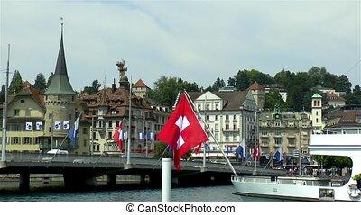 Swiss flag on boat by the Seebr?cke bridge in Luzern, Lucerne, Switzerland.